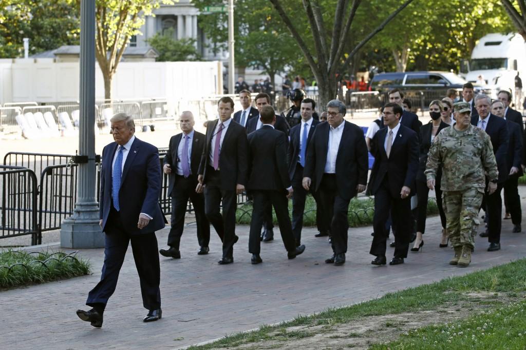President Donald Trump walks in Lafayette Park to visit outside St. John's Church across from the White House Monday, June 1, 2020, in Washington. Par...