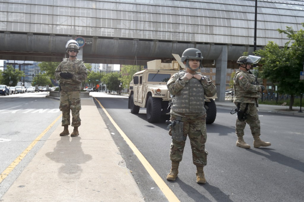 Members of an Illinois National Guard Military Police stand a post, Monday, June 1, 2020, at a security perimeter on Chicago's near Southside. (AP Pho...