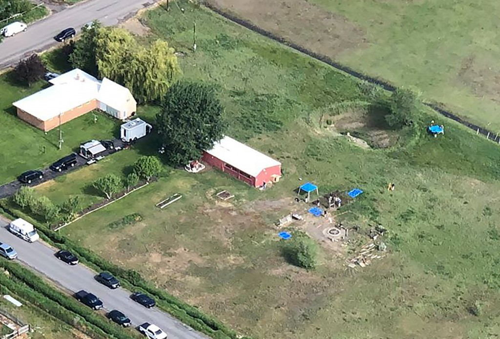 CORRECTS LOCATION TO SALEM, IDAHO, INSTEAD OF REXBURG  This aerial photo provided by East Idaho News shows authorities investigating a home in Salem, ...