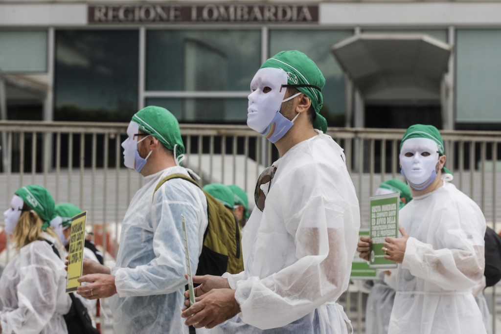 Nurses belonging to NurSind stage a protest in front of the Pirelli skyscraper hosting the Lombardy Region headquarters, in Milan, Italy, Wednesday, J...