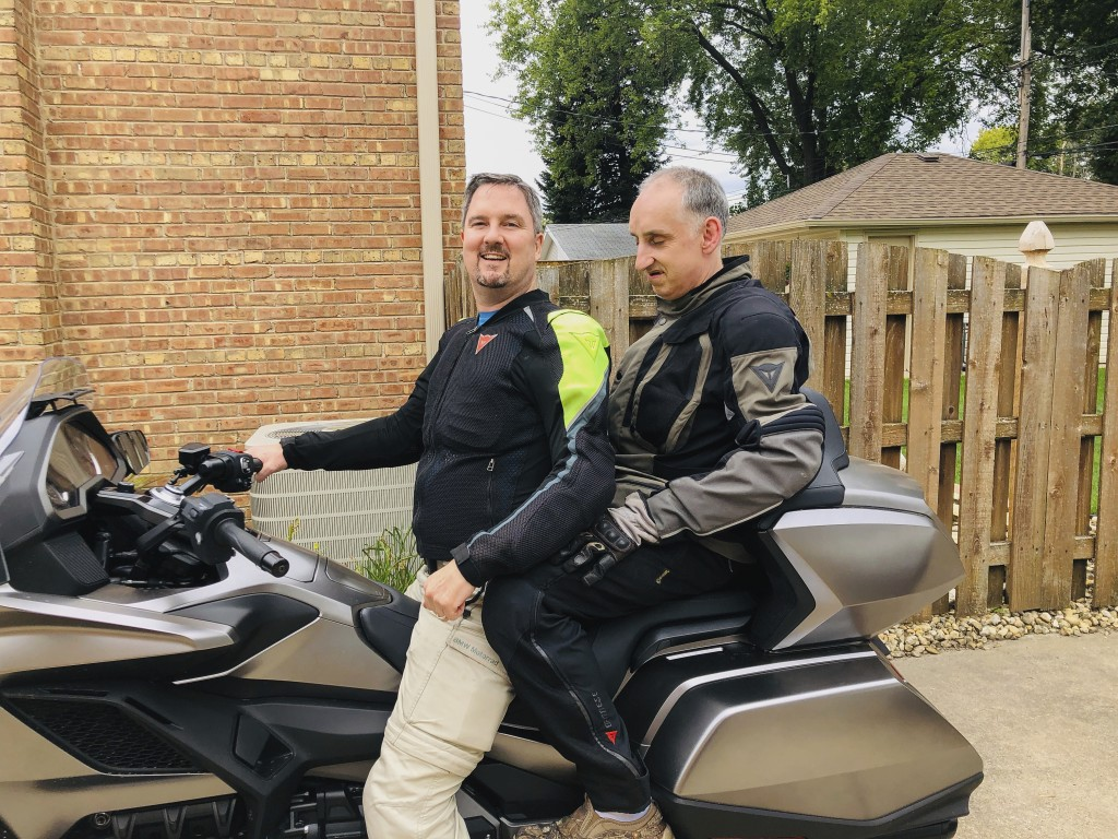 This 2019 photo provided by the family shows Joe Sullivan, right, of the Chicago-area, with his brother, Neil. When COVID-19 began spreading across th...