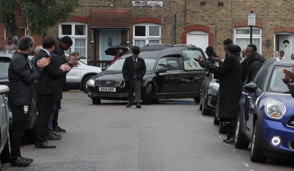 Grass roots soccer referees form a guard of honour and clap for the hearse with Jermaine Wright, a referee of the Hackney Marshes grassroots football ...