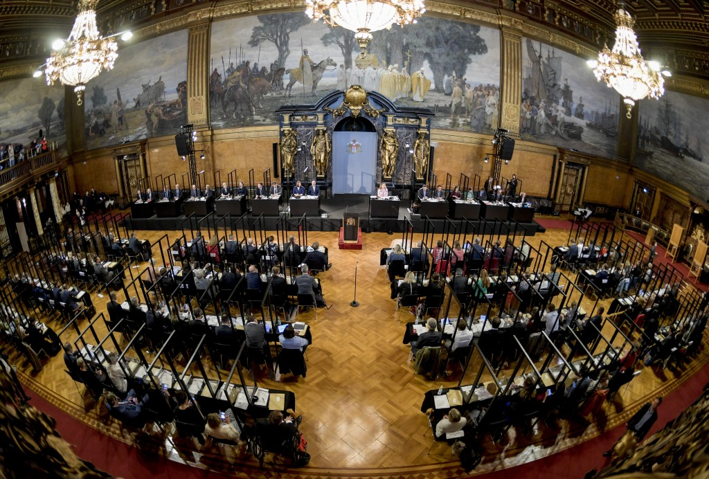 Delegates attend a meeting of the Hamburg state Parliament in Hamburg, Germany, Wednesday, June 10, 2020 at their seats, which are individually separa...