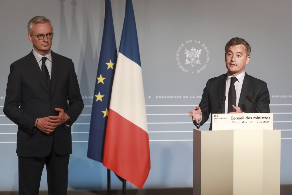 French Finance Minister Bruno Le Maire, left, and Budget Minister Gerald Darmanin attend a press conference after the weekly cabinet meeting, Wednesda...