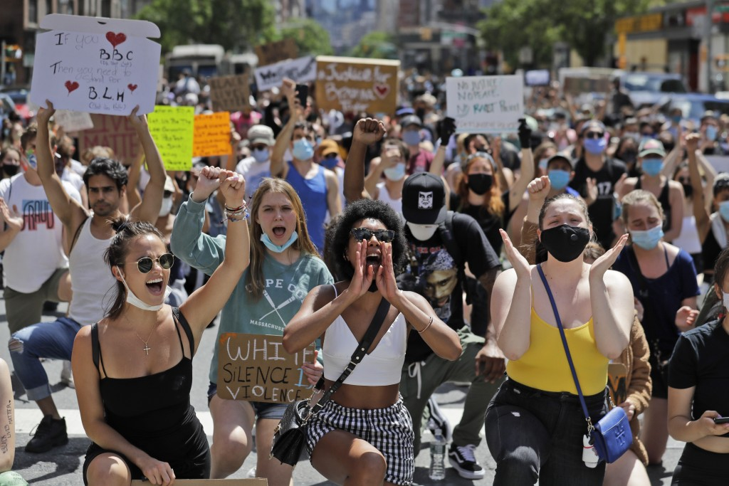 Protesters march through the streets of Manhattan, New York, Sunday, June 7, 2020. New York City lifted the curfew spurred by protests against police ...