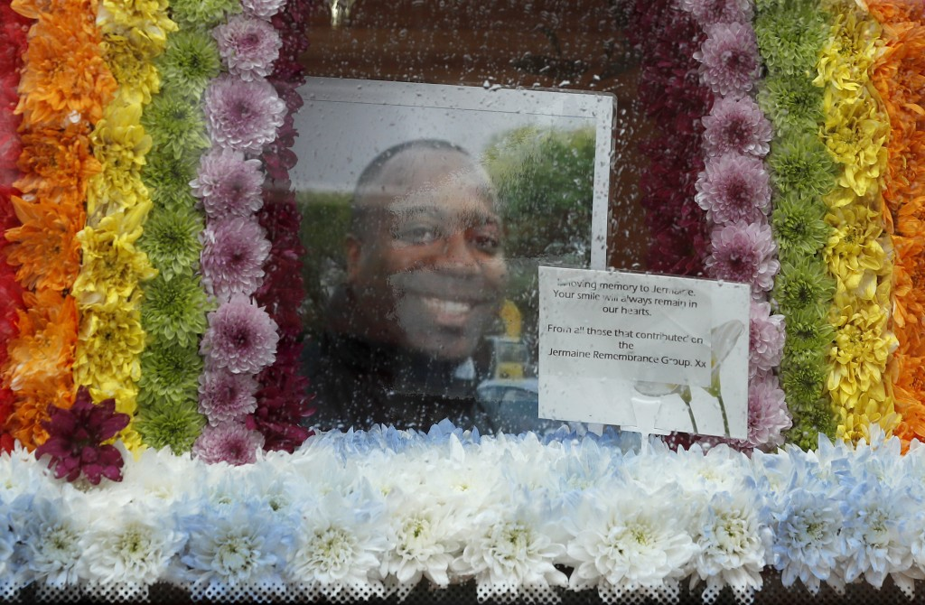 A picture of Jermaine Wright, a referee of the Hackney Marshes grassroots football league who died of COVID-19,  is placed in a rainbow of flowers ins...
