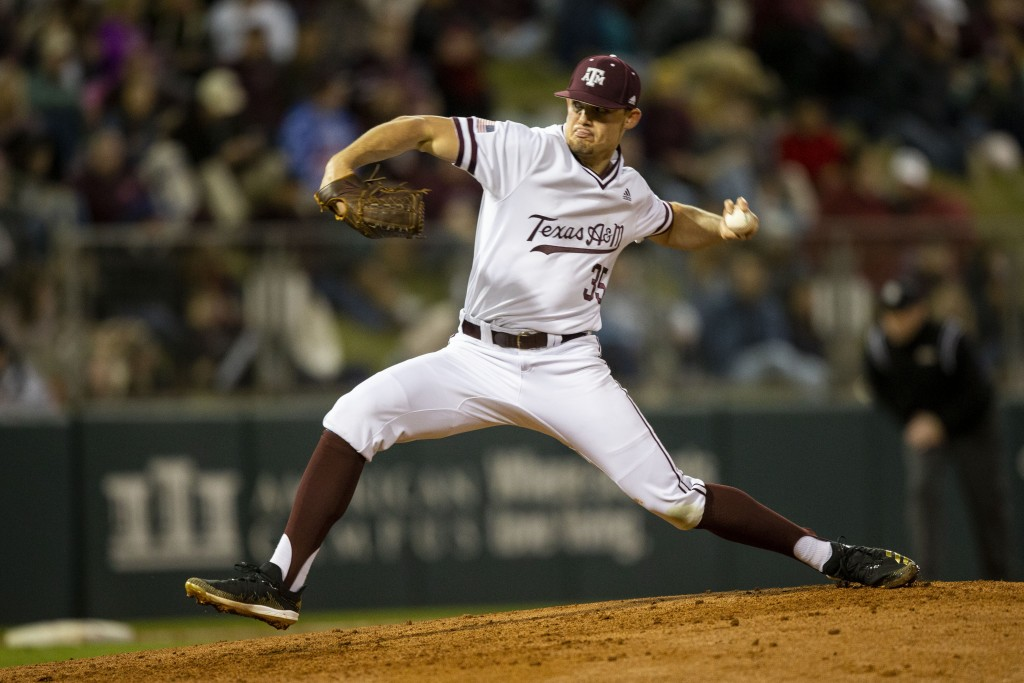 FILE - In this Feb. 14, 2020, file photo, Texas A&M's Asa Lacy (35) throws a strike against a Miami (Ohio) batter during an NCAA baseball game in Coll...