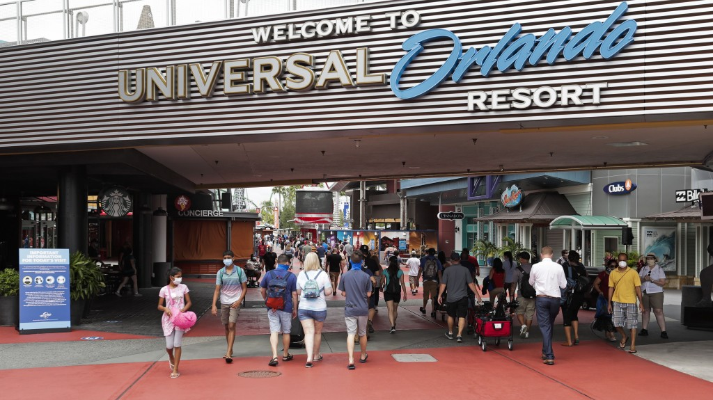 FILE—In this June 3, 2020 file photo, visitors arrive at Universal Studios, in Orlando, Fla. Amusement parks of all sizes are adjusting everything fro...