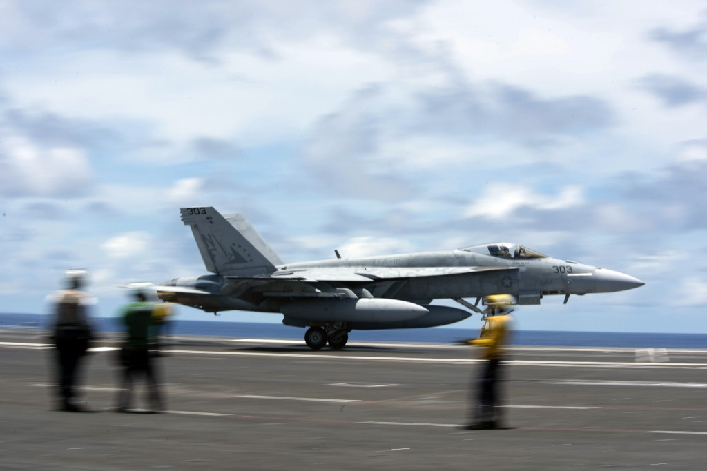 """200610-N-ML137-1057 PHILIPPINE SEA (June 10, 2020) In this image provided by the U.S. Navy, an F/A-18E Super Hornet attached to the """"Eagles"""" of Strike..."""