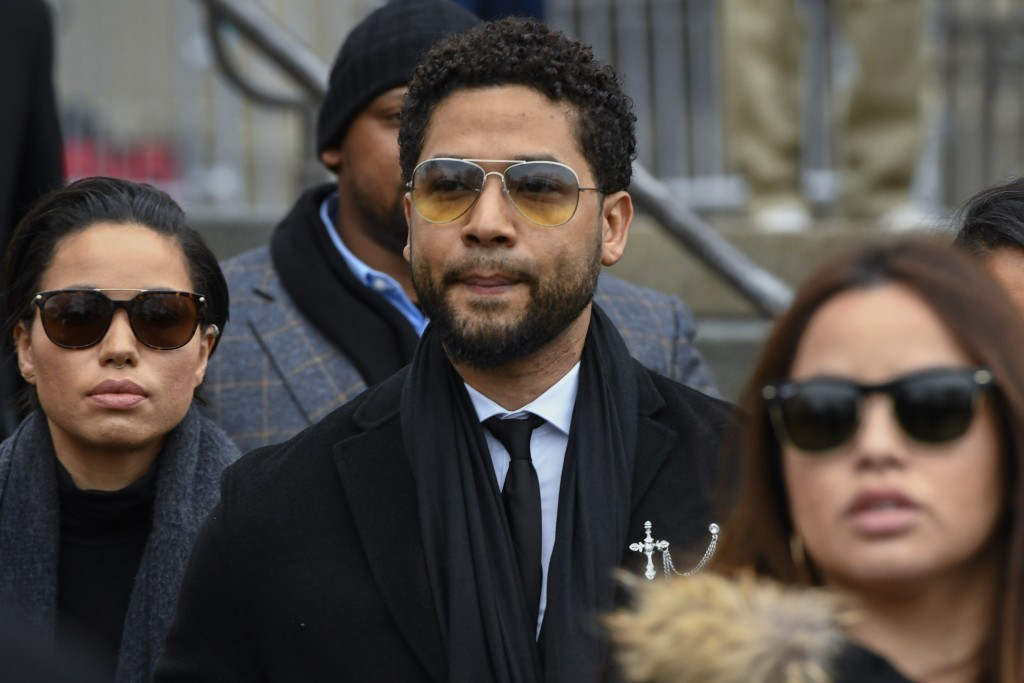 """FILE - In this Feb. 24, 2020 file photo, former """"Empire"""" actor Jussie Smollett leaves the Leighton Criminal Courthouse in Chicago, after an initial co..."""