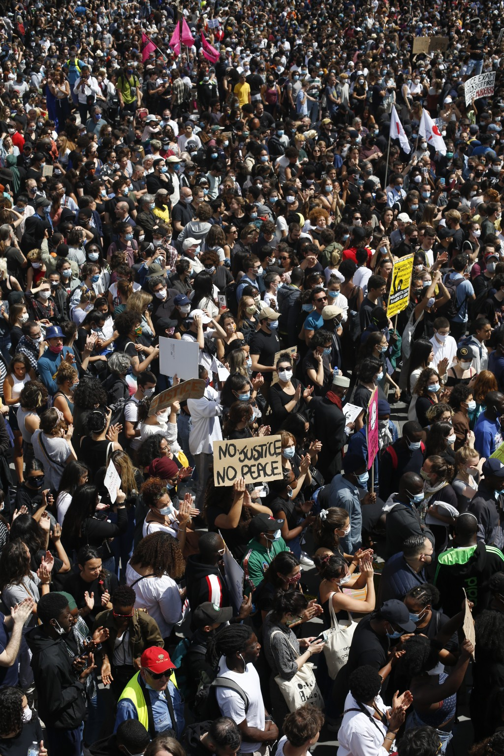 Thousands of people take part in a march against police brutality and racism in Paris, France, Saturday, June 13, 2020, organized by supporters of Ada...