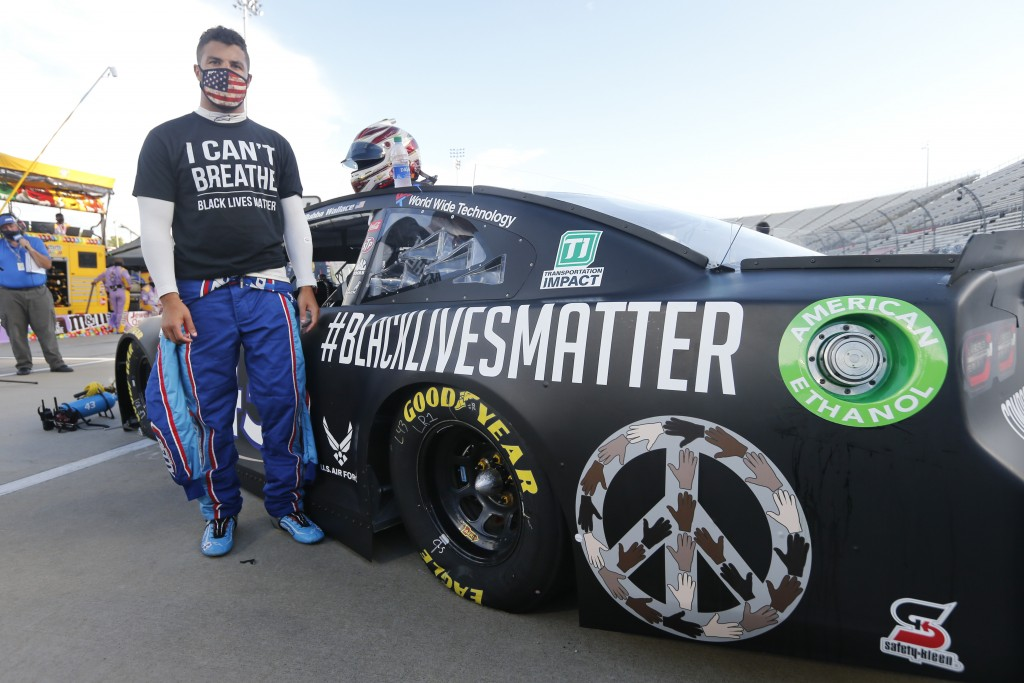FILE - In this June 10, 2020, file photo, driver Bubba Wallace waits for the start of a NASCAR Cup Series auto race in Martinsville, Va. Bubba Wallace...