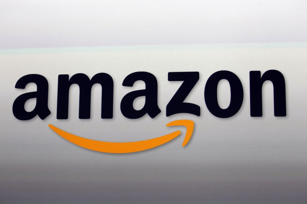 FILE - In this Sept. 6, 2012, file photo is the Amazon logo in Santa Monica, Calif. State officials in California and Washington are reviewing Amazon'...