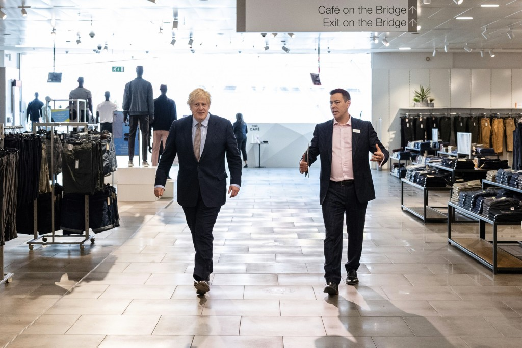 Britain's Prime Minister Boris Johnson, left, speaks with Andrew Icke, store manager of M&S Westfield Stratford at Westfield Stratford shopping centre...