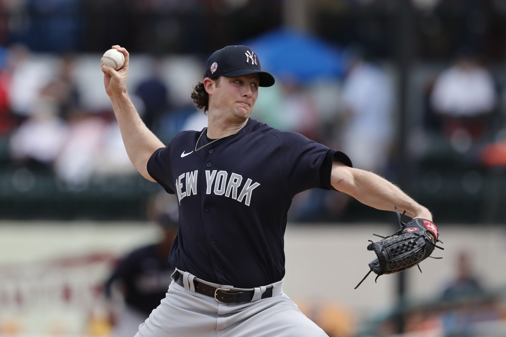 FILE - In this March 5, 2020, file photo, New York Yankees starting pitcher Gerrit Cole throws during a spring training baseball game against the Detr...