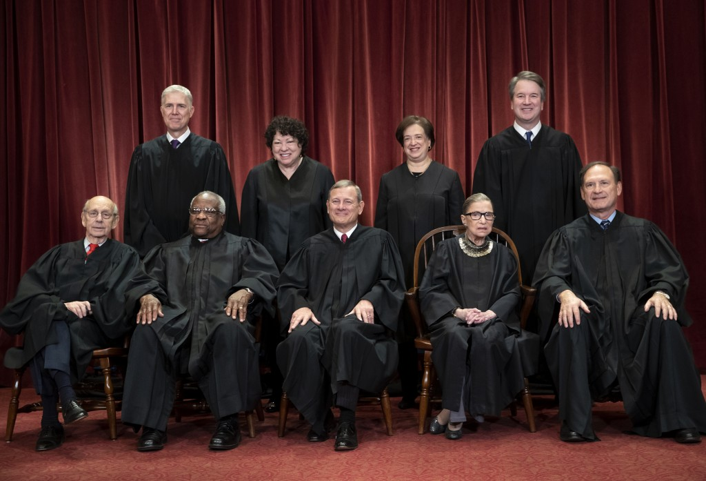 FILE - In this Nov. 30, 2018, file photo, the justices of the U.S. Supreme Court gather for a formal group portrait to include a new Associate Justice...
