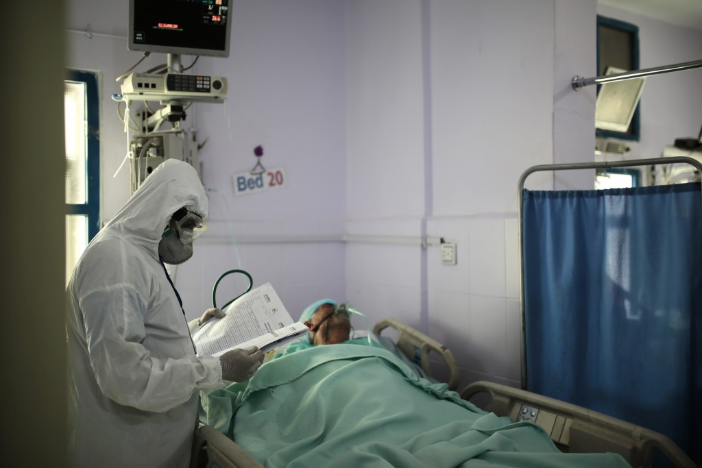 A medical worker wearing personal protective equipment takes care of a COVID-19 patient in an intensive care unit at a hospital in Sanaa, Yemen, Sunda...