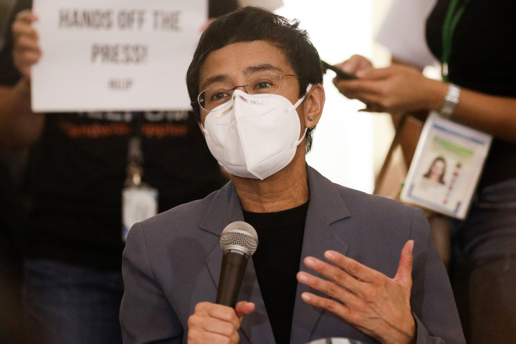 Rappler CEO and Executive Editor Maria Ressa gestures during a press conference near the Manila Regional Trial Court in Manila, Philippines on June 15...