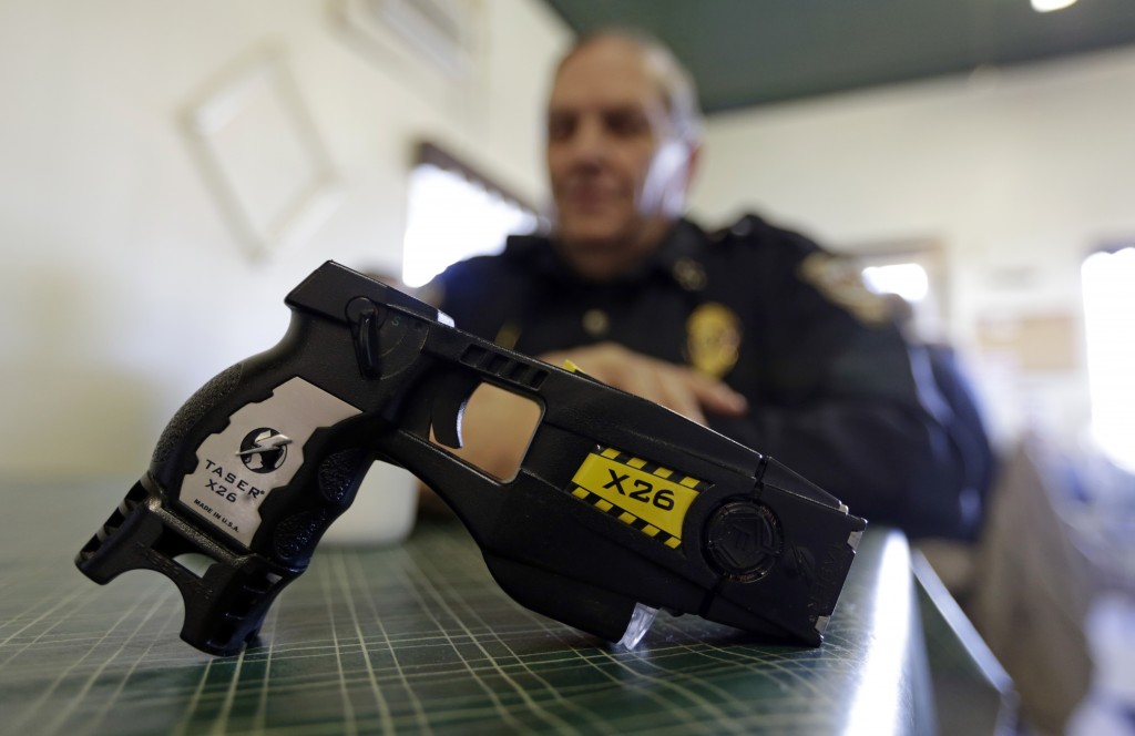 ADDS AN UPDATE FROM THE FRENCH GOVERNMENT - FILE - In this Nov. 14, 2013, file photo, a Taser X26 sits on a table in Knightstown, Ind. After France ba...