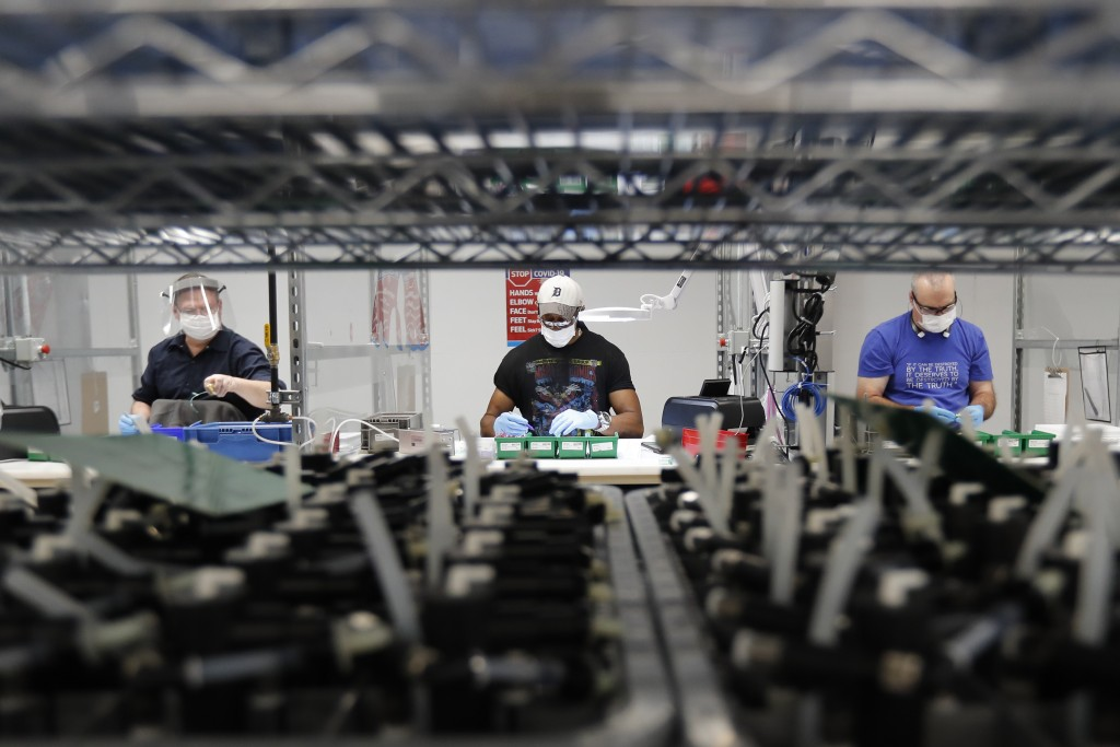 FILE - In this May 13, 2020, file photo, Ford Motor Co., line workers put together ventilators that the automaker is assembling at the Ford Rawsonvill...