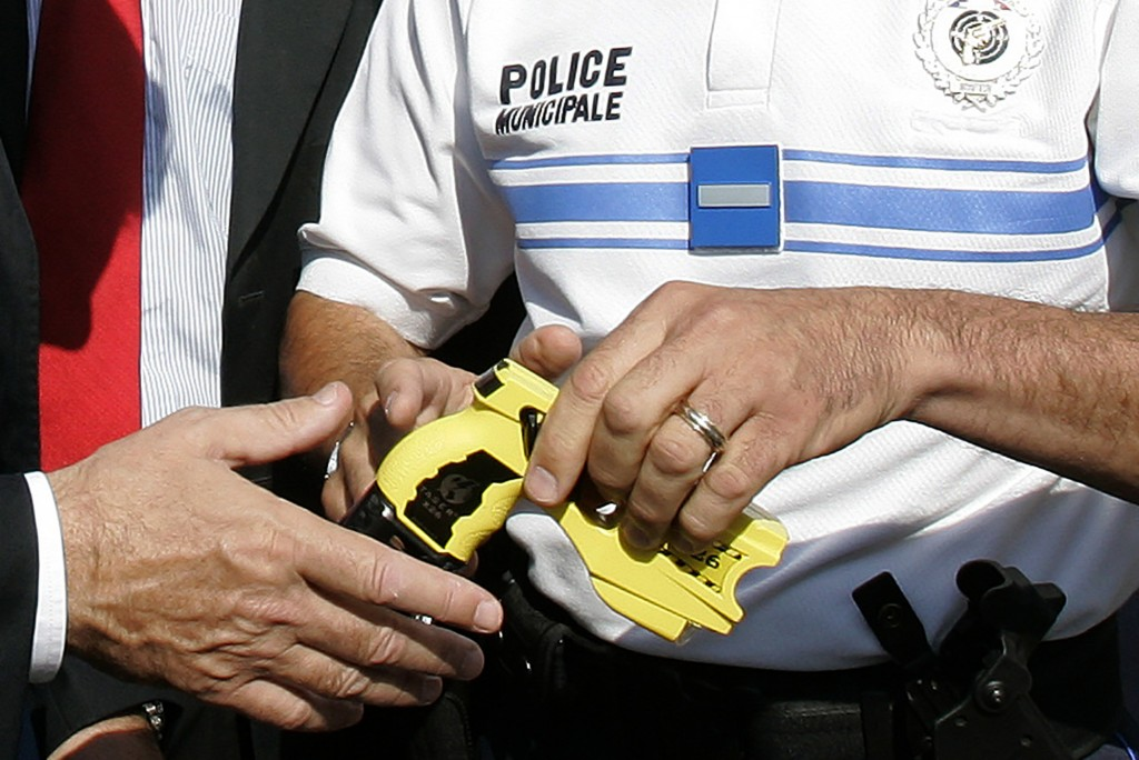 ADDS AN UPDATE FROM THE FRENCH GOVERNMENT - FILE - In this July 10, 2009, file photo, a police officer hands over a Taser to a local politician in Nic...