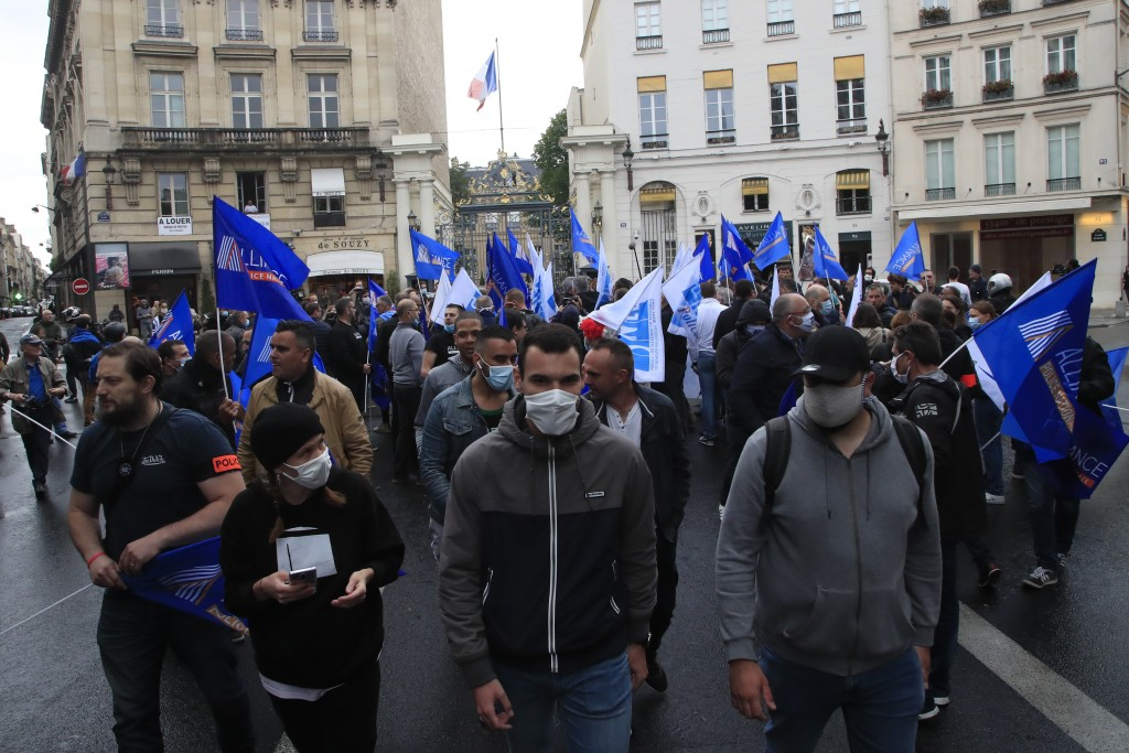 ADDS AN UPDATE FROM THE FRENCH GOVERNMENT - FILE - In this June 12, 2020, file photo, French police unionists demonstrate in front of the Interior Min...