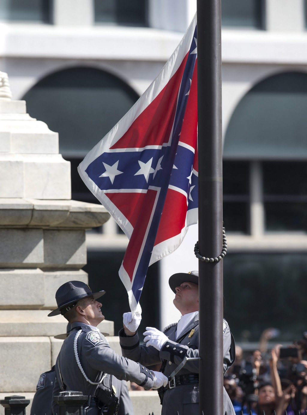 FILE - In a Friday, July 10, 2015 file photo, an honor guard from the South Carolina Highway patrol removes the Confederate battle flag from the Capit...