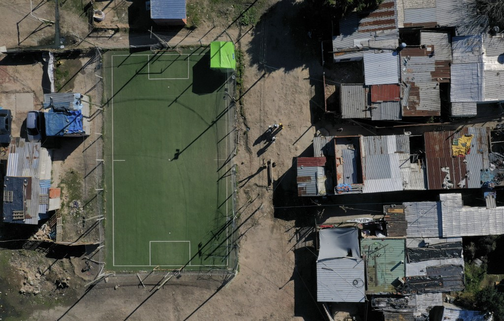 A soccer field is empty in the Villa Azul neighborhood while soccer is canceled, one of many measures to curb the spread of COVID-19, in Buenos Aires,...