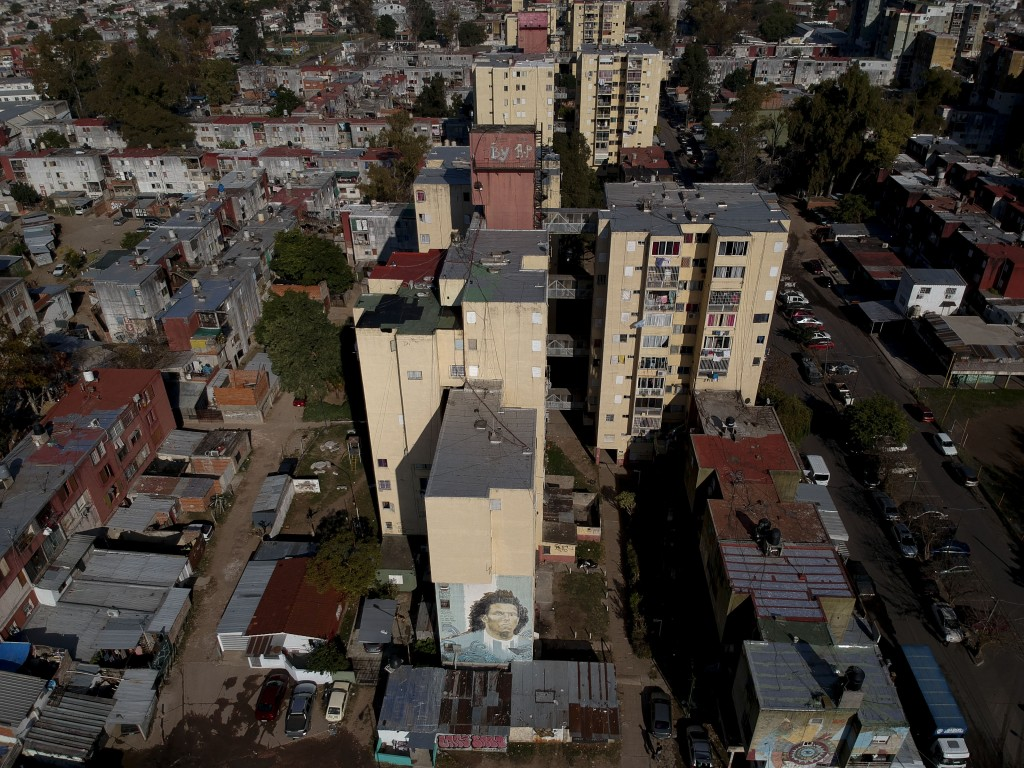 A mural of Argentine soccer star Carlos Tevez covers an apartment building in the Fuerte Apache neighborhood where he played as a youth in Buenos Aire...