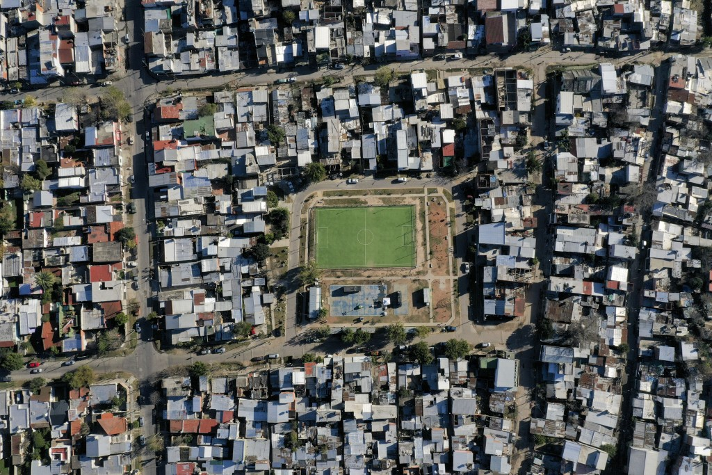Homes surround a soccer field in the Villa Itati neighborhood of Buenos Aires, Argentina, Sunday, June 14, 2020, where Sergio Aguero, who plays with M...