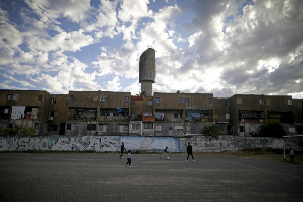 Children play soccer on a paved soccer field, where Argentina's soccer star Carlos Tevez played according to residents, during a lockdown to curb the ...