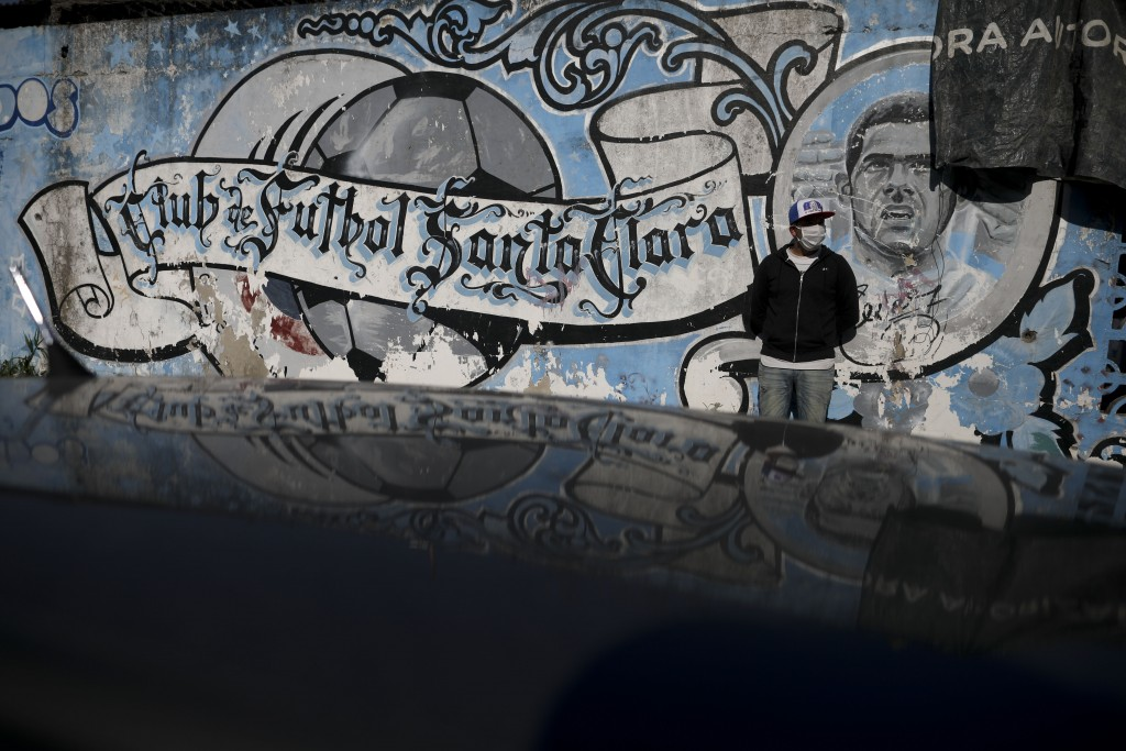 Daniel Lopez, president of the Santa Clara soccer club where Argentina's soccer star Carlos Tevez started playing, poses for a portrait by a mural at ...