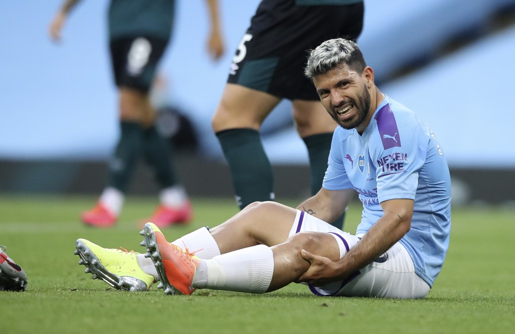 Manchester City's Sergio Aguero reacts as he sits on the pitch injured during the English Premier League soccer match between Manchester City and Burn...