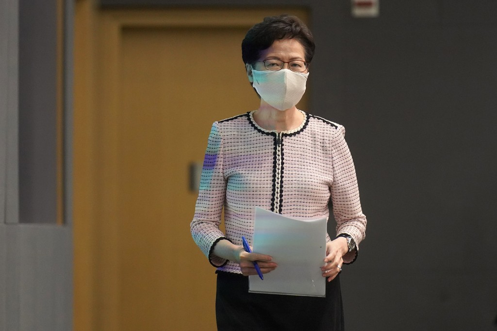 Hong Kong Chief Executive Carrie Lam arrives at a press conference in Hong Kong, Tuesday, June 23, 2020. Lam restated that the controversial National ...