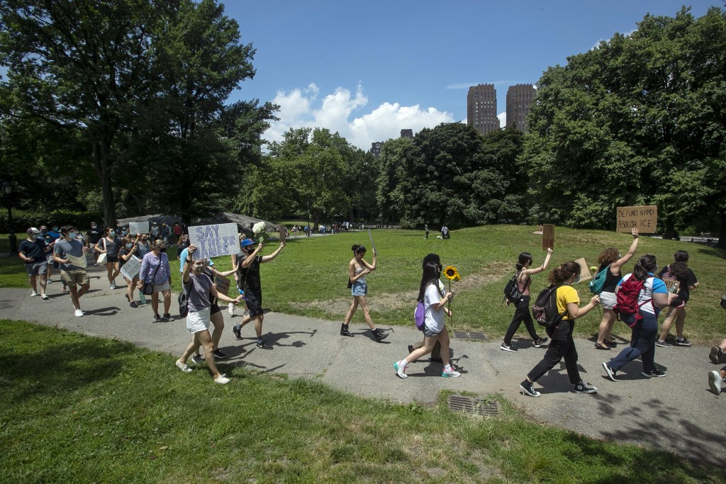 People march through Central Park, during a Juneteenth celebration Friday, June 19, 2020, in New York. Juneteenth marks the day in 1865 when federal t...