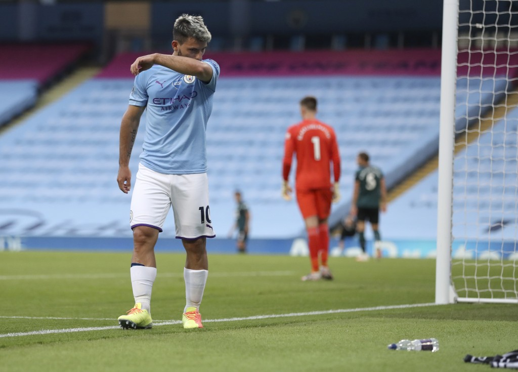 Manchester City's Sergio Aguero reacts as he leaves the field injured during the English Premier League soccer match between Manchester City and Burnl...
