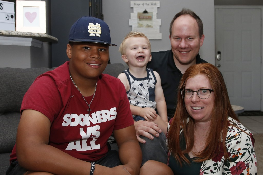 The Dunn family is pictured in their home Friday, June 12, 2020, in Oklahoma City. From left are Izzy Simons, Cooper Dunn, Josh Dunn and Sarah Dunn. S...