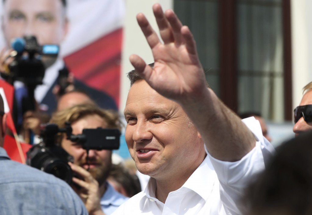 Polish President Andrzej Duda waves to supporters as he campaigns for a second term in Serock, Poland, on Wednesday, June 17, 2020, Duda is the frontr...