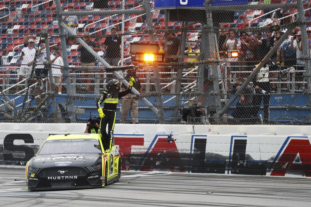 Ryan Blaney (12) celebrates after winning a NASCAR Cup Series auto race at Talladega Superspeedway in Talladega Ala., Monday, June 22, 2020. (AP Photo...