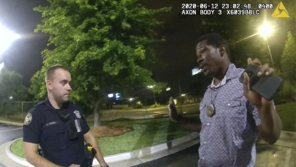 FILE - This screen grab taken from body camera video provided by the Atlanta Police Department shows Rayshard Brooks speaking with Officer Garrett Rol...