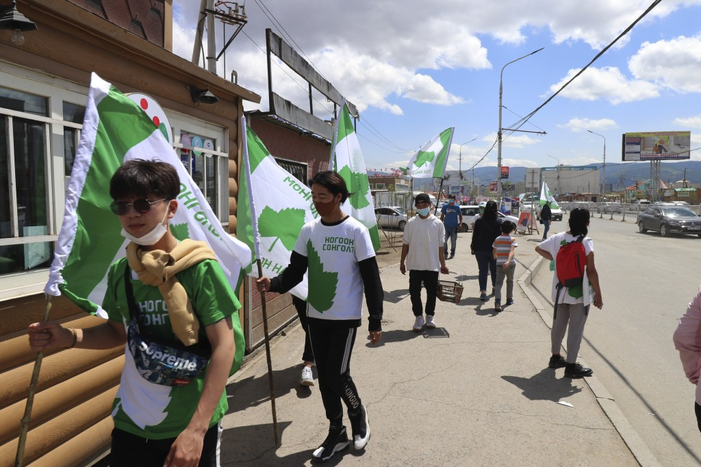 Election workers and supporters of Mongolian Green Party wearing green and white t-shirt campaign in the Chingeltei district, northern outskirt of Ula...