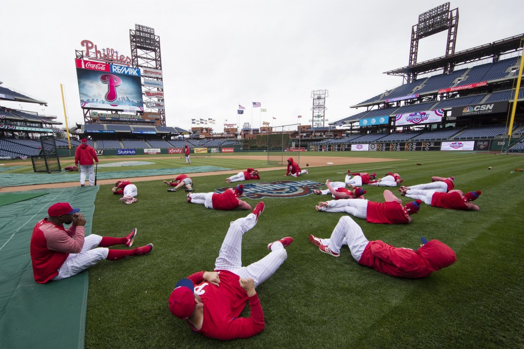 FILE - In this April 7, 2017, file photo, members of the Philadelphia Phillies stretch before the team's baseball game against the Washington National...