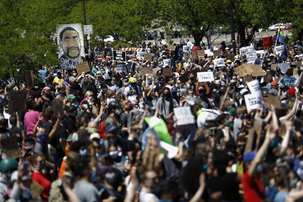 FILE - In this May 30, 2020, file photo, people gather for a rally in Minneapolis, following the death of George Floyd. George Soros, the billionaire ...