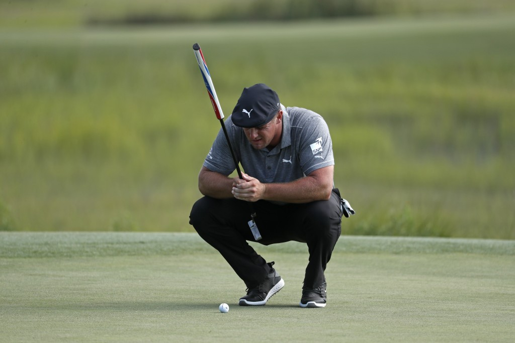 Bryson DeChambeau lines up a shot on the 18th green during the third round of the RBC Heritage golf tournament, Saturday, June 20, 2020, in Hilton Hea...