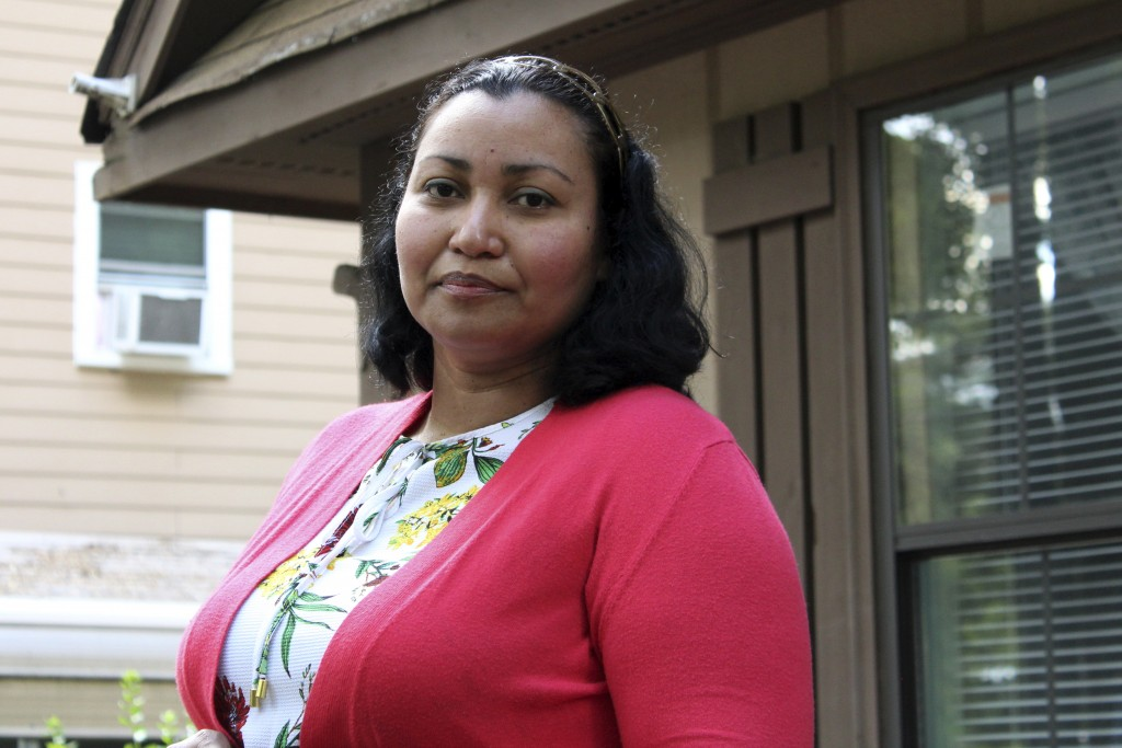 In this Thursday, June 18, 2020, photo, Honduran native Lidia Reyes poses for a photo in Durham, N.C. Reyes returned to her home in Durham after being...