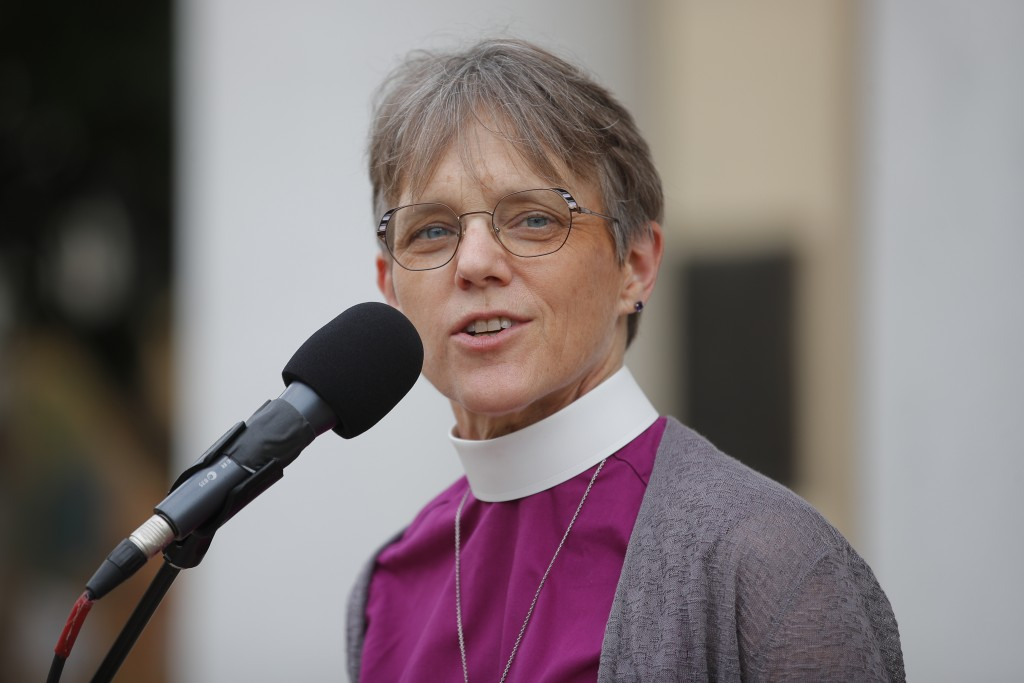 Bishop Mariann Edgar Budde of the Esiscopal Diocese of Washington speaks during a service outside St. John's Episcopal Church near the White House in ...