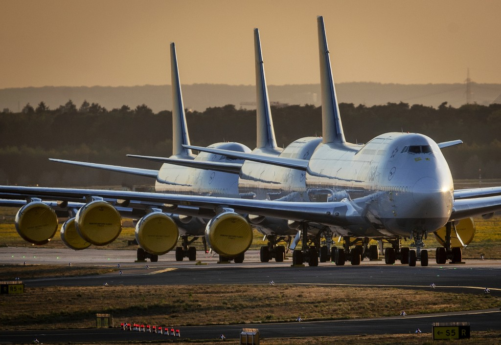 FILE - In this Monday, April 20, 2020 file photo, Boeing 747 aircrafts of German Lufthansa are parked at the airport in Frankfurt, Germany. After almo...