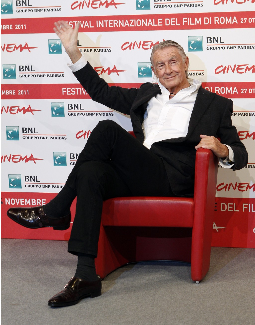 FILE - In this Nov. 3, 2011 file photo, director Joel Schumacher waves during a photo call for Cinema and Advertising: Joel Schumacher directs Campari...