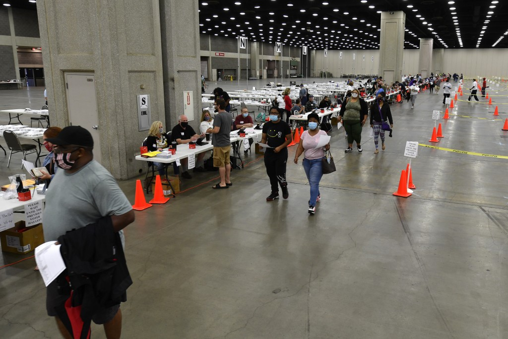 Voters head to the designated area to fill out their ballots in the kentucky primary at the Kentucky Exposition Center in Louisville, Ky., Tuesday, Ju...