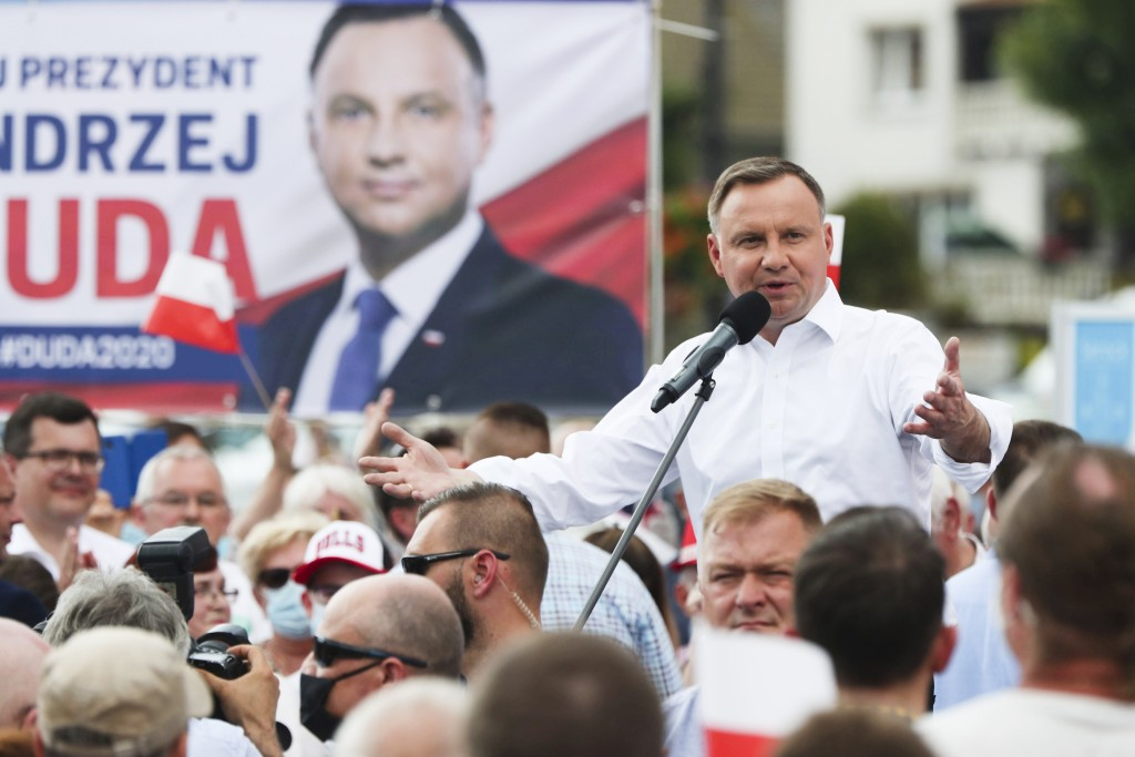 Polish President Andrzej Duda waves to supporters as he campaigns for a second term in Serock, Poland, on Wednesday, June 17, 2020.Duda is the frontru...